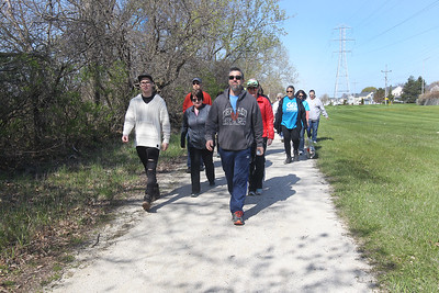 Candace H. Johnson-For Shaw Media A group of walkers stay together as they walk along a path during the Go Gurnee Walk which started out at 1821 N. Dilleys Road in Gurnee. The Go Gurnee Walk is presented by the Gurnee Park District. The walks are scheduled at different locations every Saturday from 9:30-11:00 am. The next walk will be on Saturday, May 11th, at 9:30 am at Illinois Beach State Park. (5/4/19)