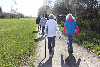 Candace H. Johnson-For Shaw Media Chris Angelos and Judi Spielman, both of Gurnee walk along a wooded path during a Go Gurnee Walk which began at 1821 N. Dilleys Road, near the water tower, in Gurnee. The Go Gurnee Walk is presented by the Gurnee Park District. The walks are scheduled at different locations every Saturday from 9:30-11:00 am. The next walk will be on Saturday, May 11th, at 9:30 am at Illinois Beach State Park. (5/4/19)