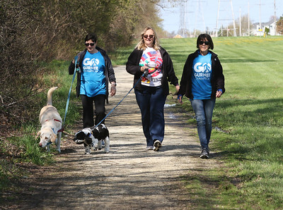 Candace H. Johnson-For Shaw Media Francesca Nelson, of Gurnee and Lori Schleibinger, of Spring Grove walk their dogs with Linda Brogren, of Gurnee during a Go Gurnee Walk along a wooded path after starting off at 1821 N. Dilleys Road in Gurnee. The Go Gurnee Walk is presented by the Gurnee Park District. The walks are scheduled at different locations every Saturday from 9:30-11:00 am. The next walk will be on Saturday, May 11th, at 9:30 am at Illinois Beach State Park. (5/4/19)