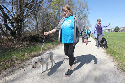Candace H. Johnson-For Shaw Media Mary Fishback, of Wadsworth walks her dog, Sadie, on a wooded path during a Go Gurnee Walk which started at 1821 N. Dilleys Road in Gurnee. The Go Gurnee Walk is presented by the Gurnee Park District. The walks are scheduled at different locations every Saturday from 9:30-11:00 am. The next walk will be on Saturday, May 11th, at 9:30 am at Illinois Beach State Park. (5/4/19)