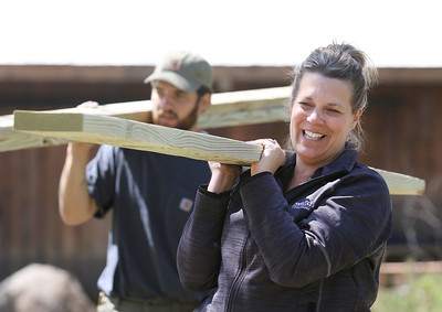 Candace H. Johnson-For Shaw Media Mateo Dituro, of Antioch and Michelle Haluzak, of Spring Grove carry wooden slats to other volunteers as they build an outdoor classroom next to the Hiram Buttrick Sawmill in Gage Brothers Park during NorthBridge Church's Spring ShareFest in Antioch. (5/4/19)