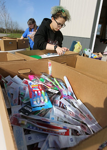 Candace H. Johnson-For Shaw Media Michelle Renollet works with Diamond Biggs, 16, both of Zion, sorting personal items donated for Open Arm's Mission during Spring ShareFest at the NorthBridge Church in Antioch. (5/4/19)