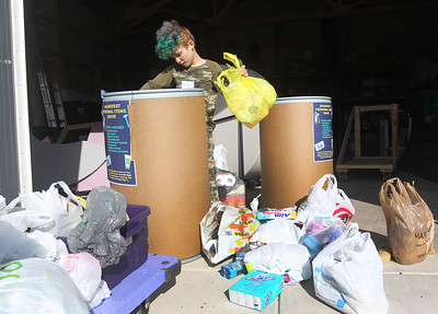 Candace H. Johnson-For Shaw Media Jamar Libasci, 9, of Zion takes bags of donated personal items out of bins to be sorted for Open Arm's Mission during Spring ShareFest at NorthBridge Church in Antioch. (5/4/19)