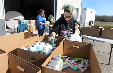 Candace H. Johnson-For Shaw Media Michelle Renollet works with Jamar Libasci, 9, and his sister, Diamond Biggs, 16, all of Zion, to sort personal items donated for Open Arm's Mission during Spring ShareFest at the NorthBridge Church in Antioch. (5/4/19)