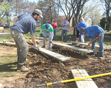 Candace H. Johnson-For Shaw Media Mateo Dituro, 21, of Antioch loosens up the dirt with a team of volunteers as they all work on building an outdoor classroom next to the Hiram Buttrick Sawmill in Gage Brothers Park during NorthBridge Church's ShareFest in Antioch. (5/4/19)