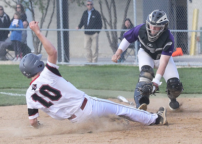 Candace H. Johnson-For Shaw Media Antioch's Sean Weiser slides into home as he he tagged out by Wauconda's Camden Janik in the third inning at Antioch Community High School. Wauconda won 5-3. (5/14/19)