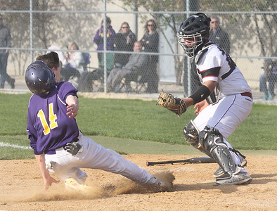 Candace H. Johnson-For Shaw Media Wauconda's Josh Kehl slides in safely at home plate under the tag by Antioch's Kylar Arias in the fourth inning at Antioch Community High School. Wauconda won 5-3. (5/14/19)