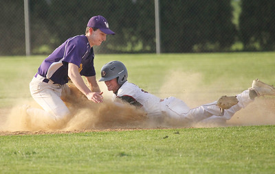 Candace H. Johnson-For Shaw Media Wauconda's Jacob Jensen puts the tag on Antioch's Ethan Andrews at second for an out in the seventh inning at Antioch Community High School. Wauconda won 5-3. (5/14/19)