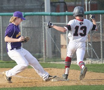 Candace H. Johnson-For Shaw Media Wauconda's Riley Kirk makes it to first for an out against Antioch's Tyler Skutnik in the fifth inning at Antioch Community High School. Wauconda won 5-3. (5/14/19)