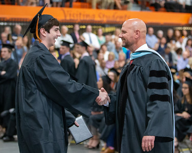 Anthony Beck shakes hands with school Principal Dr. Eric Ernd during the Class of 2019 Crystal Lake Central Commencement Ceremony held Saturday, May 18, 2019 in Crystal Lake.