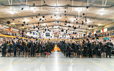 Caps fly in the air as the 2019 Crystal Lake Central graduating class celebrates following the commencement ceremony Saturday, May 18, 2019 in Crystal Lake.