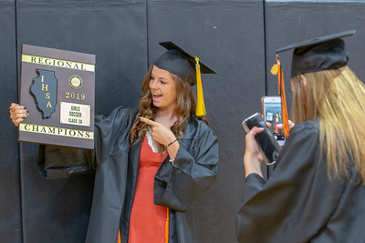 Abbey Kramer gets her photo taken with the Class 2A Regional Soccer trophy by classmate Megan Wozniak prior to the Class of 2019 Crystal Lake Central Commencement Ceremony held Saturday, May 18, 2019 in Crystal Lake.