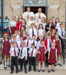 Students from the St. John the Baptist School pose for a photo with Bishop David Malloy of the Rockford Diocese (back row, center) outside of St. John the Baptist Church in Johnsburg. Bishop Malloy was on hand to celebrate the St. John the Baptist School's 175th anniversary.