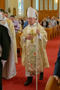 Bishop David Malloy of the Rockford Diocese enters St. John the Baptist Church Sunday, May 19, 2019 in Johnsburg. Bishop Malloy was on hand to celebrate the St. John the Baptist School's 175th anniversary. KKoontz – For Shaw Media