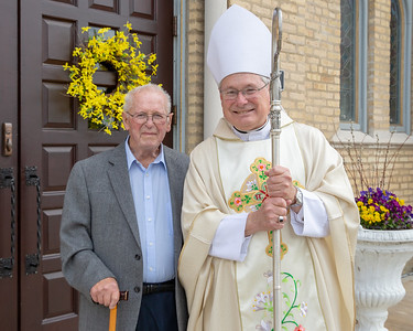 Harry Smith (left) poses for a photo with Bishop David Malloy of the Rockford Diocese Sunday, May 19, 2019 outside of St. John the Baptist Church in Johnsburg. Smith graduated from the St. Johns the Baptist School in 1939 and was there to celebrate the school's 175th anniversary. KKoontz – For Shaw Media
