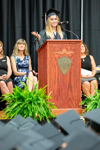 Harvard senior class president Emily Bokowy addresses the graduates during the 2019 Harvard High School Commencement ceremony Sunday, May 19, 2019 in Harvard.