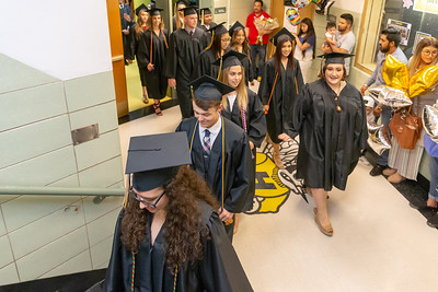 Students make their way into the gymnasium before the 2019 Harvard High School Commencement ceremony Sunday, May 19, 2019 in Harvard.