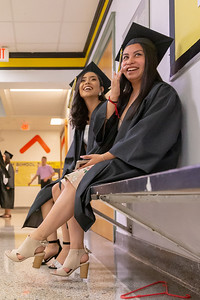 Jazzmyn Hernandez (L) and Jasmine Rojas (R) share a laugh before the 2019 Harvard High School Commencement ceremony Sunday, May 19, 2019 in Harvard.
