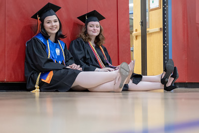 Lexi DeWitt and Maria Bowers wait in the student assembly area prior to the 2019 McHenry East Commencement Ceremony Wednesday, May 22, 2019 in McHenry.