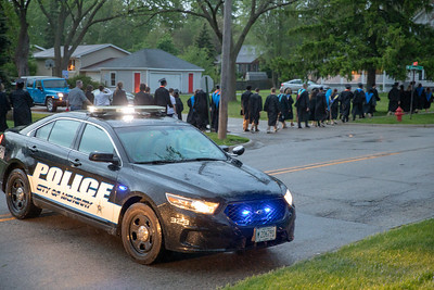 McHenry Police shut down Green Street in McHenry to assist moving the 2019 McHenry East Commencement Ceremony from McCracken Field to the East Campus Gymnasium Wednesday, May 22, 2019. The ceremony was halted due to lightening in the area.