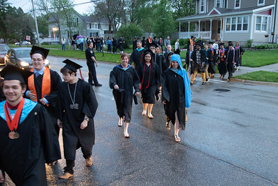 Students, faculty, and families move from McCracken Field during the 2019 McHenry East Commencement Ceremony Wednesday, May 22, 2019 in McHenry. The ceremony was halted due to lightening in the area, and later finished inside the gymnasium at East Campus. KKoontz – For Shaw Media