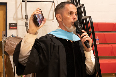 McHenry East Campus Principal, Dr. Jeff Prickett makes the announcement that the 2019 Commencement Ceremony would be moved from McCracken Field to the gymnasium at East Campus Wednesday, May 22, 2019. The ceremony was interrupted due to lightening in the area.