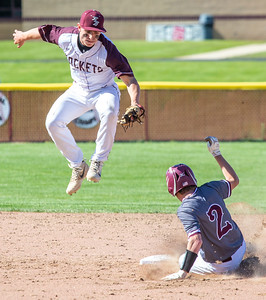 Richmond-Burton's Dalton Wood saves a ball from going into the outfield as Marengo's Derek Peters steals second in the first-round sectional game Thursday, May 23, 2019 in Richmond. Richmond went on to win 5-4 and will face Carmel on Saturday. KKoontz – For Shaw Media