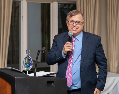 Randy Funk, on behalf of the Lions Club, accepts the Carl E. Wehde Member of the Year Award at the annual Crystal Lake Chamber of Commerce awards dinner Thursday, May 23, 2019 at the Crystal Lake Country Club in Crystal Lake. KKoontz – For Shaw Media