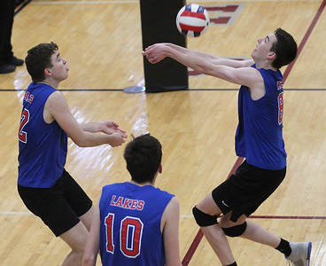 Candace H. Johnson-For Shaw Media Lakes Benjamin Mercure, Broderick Solbrig and Tyler Donovan work together to return the ball against Zion-Benton in the third set during the regional semifinal game at Antioch Community High School. Lakes won 23-25, 25-17, 25-14. (5/21/19)