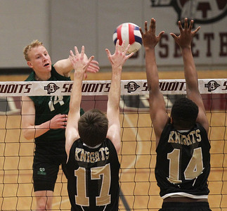 Candace H. Johnson-For Shaw Media Grayslake Central's Isaac Dahlstrom makes an attack against Grayslake North's Nicholas LeBaron and Ein Atwater in the first set during the regional semifinal game at Antioch Community High School. Grayslake Central won 20-25, 25-22, 25-21. (5/21/19)
