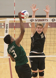 Candace H. Johnson-For Shaw Media Grayslake Central's Emmanuel Eugene makes an attack against Grayslake North's Teddy Gedville in the second set during the regional semifinal game at Antioch Community High School. Grayslake Central won 20-25, 25-22, 25-21. (5/21/19)
