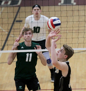 Candace H. Johnson-For Shaw Media Grayslake Central's Ethan Bond and Kaleb Patrick watch Grayslake North's Teddy Gedville set the ball across the court during the regional semifinal game at Antioch Community High School. Grayslake Central won 20-25, 25-22, 25-21. (5/21/19)