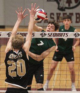 Candace H. Johnson-For Shaw Media Grayslake Central's Jacob Spicer (#7) makes an attack against Grayslake North's Evan Mittlestaedt in the first set during the regional semifinal game at Antioch Community High School. Grayslake Central won 20-25, 25-22, 25-21. (5/21/19)