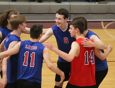 Candace H. Johnson-For Shaw Media Lakes Tyler Donovan (#8) and his team come together to celebrate a point against Zion-Benton in the third set during the regional semifinal game at Antioch Community High School. Lakes won 23-25, 25-17, 25-14. (5/21/19)