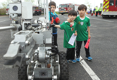 Candace H. Johnson-For Shaw Media Sebastian Santi, 5, of Gurnee, Rio Buchanan, 4, and his brother, Kai, 6, watch the robot from the Waukegan Fire Department bomb team move during the 22nd Annual Fire Safety Expo at Gurnee Mills. (5/18/19)