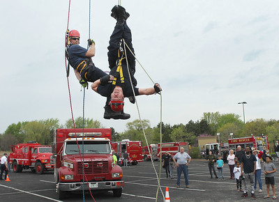 Candace H. Johnson-For Shaw Media Firefighters Tim Morony, with the Deerfield Bannockburn Fire Department, and John Gaffke, with the Libertyville Fire Department demonstrate how they repel down a rescue line from a one-hundred foot ladder tower during the 22nd Annual Fire Safety Expo at Gurnee Mills. (5/18/19)
