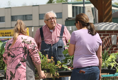 Candace H. Johnson-For Shaw Media Dr. Lew Seidenberg (center) answers questions and helps Renee Wright, both of Grayslake and Maria Arroyo-Trotz, of Gages Lake with picking out different plants during the Grayslake Greenery Garden Club Annual Plant Sale in the parking lot close to the Village Hall in Grayslake. (5/18/19)