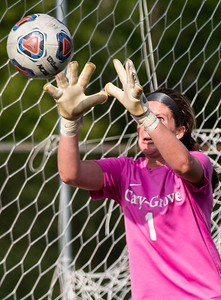 Cary Grove goal keeper Makenna Sheehan blocks a shot on goal in the first half of the 3A Guilford soccer sectional in Rockford on Friday, May 24, 2019. Randy Stukenberg for Shaw Media