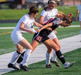 Cary Grove's Summer Curtis, left, and Maddie Jannusch struggle with Barrington's Tina Teik to get control of the ball in the second half of the 3A Guilford soccer sectional in Rockford on Friday, May 24, 2019. Randy Stukenberg for Shaw Media