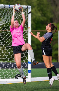 Cary Grove goal keeper Makenna Sheehan leaps to block a shot on goal in front of Barrington's Ashley Armando in the first half of the 3A Guilford soccer sectional in Rockford on Friday, May 24, 2019. Randy Stukenberg for Shaw Media