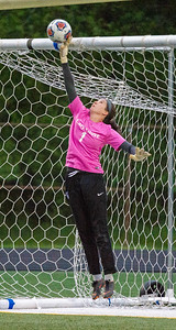 Cary Grove goal keeper Makenna Sheehan blocks a shot on goal in the second half of the preliminary game  of the 3A Guilford Sectional on Tuesday, May 21, 2019. Randy Stukenberg for Shaw Media.
