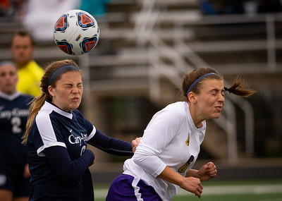 Cary Groves Jordan Dale heads the ball away from Hononegah's Eva Eiss in the first half of the preliminary game  of the 3A Guilford Sectional on Tuesday, May 21, 2019. Randy Stukenberg for Shaw Media.