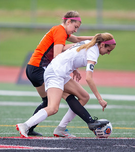 Crystal Lake Central's Megan Wozniak (left) gets a foot on the ball against Prairie Ridge's Abby Eriksen (right) in the Class 2A Hampshire Sectional Championship Saturday, May 25, 2019 in Huntley. Central wins 1-0 on a goal by Wozniak with 20 seconds left in the game. KKoontz – For Shaw Media