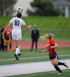 Prairie Ridge's Reanne Weil goes high to head the ball against Crystal Lake Central in the Class 2A Hampshire Sectional Championship Saturday, May 25, 2019 in Huntley. Central wins 1-0 and will advance to the Super Sectional game.  KKoontz – For Shaw Media