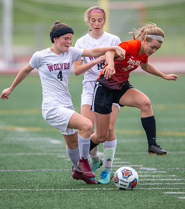 Crystal Lake Central's Erica Novy splits Prairie Ridge defenders Chelsea Gale and Caroline Golt in the Class 2A Hampshire Sectional Championship Saturday, May 25, 2019 in Huntley. Central wins 1-0 and will advance to the Super Sectional game.  KKoontz – For Shaw Media