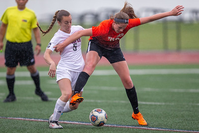 Crystal Lake Central's Emma Bolanowski (right) fights off Prairie Ridge's Olivia Ott (left) in the Class 2A Hampshire Sectional Championship Saturday, May 25, 2019 in Huntley. Central wins 1-0 and will advance to the Super Sectional game. KKoontz – For Shaw Media