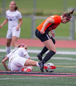 Prairie Ridge's Abby Eriksen (left) gets a foot on the ball against Crystal Lake Central's Megan Wozniak in the Class 2A Hampshire Sectional Championship Saturday, May 25, 2019 in Huntley. Central wins 1-0 on a goal by Wozniak with 20 seconds left in the game. KKoontz – For Shaw Media
