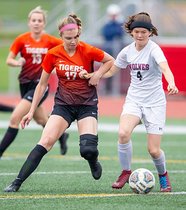 Crystal Lake Central's Megan Wozniak (Left) battles for possession with Prairie Ridge's Chelsea Gale (right) in the Class 2A Hampshire Sectional Championship Saturday, May 25, 2019 in Huntley. Central wins 1-0 on a goal by Wozniak with 20 seconds left in the game. KKoontz – For Shaw Media
