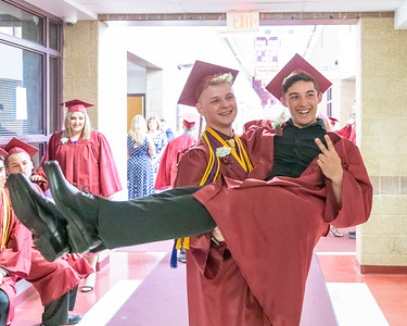 Brendon Peterson (left) gives Nathan Ryan (right) a lift prior to the 2019 Richmond-Burton Commencement Ceremony Sunday, May 26, 2019 in Richmond.   KKoontz – For Shaw Media
