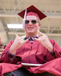 Kyle Curran celebrates after receiving his diploma at the 2019 Richmond-Burton Commencement Ceremony Sunday, May 26, 2019 in Richmond.   KKoontz – For Shaw Media